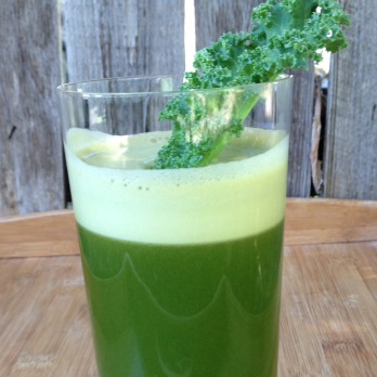 Green juice with kale sprig