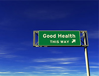 photo of good health this way sign